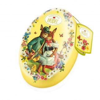 Carton de 8 oeufs métal Heidel de 103g garni de chocolat supérieur au lait, au décor nostalgie de Pâques.